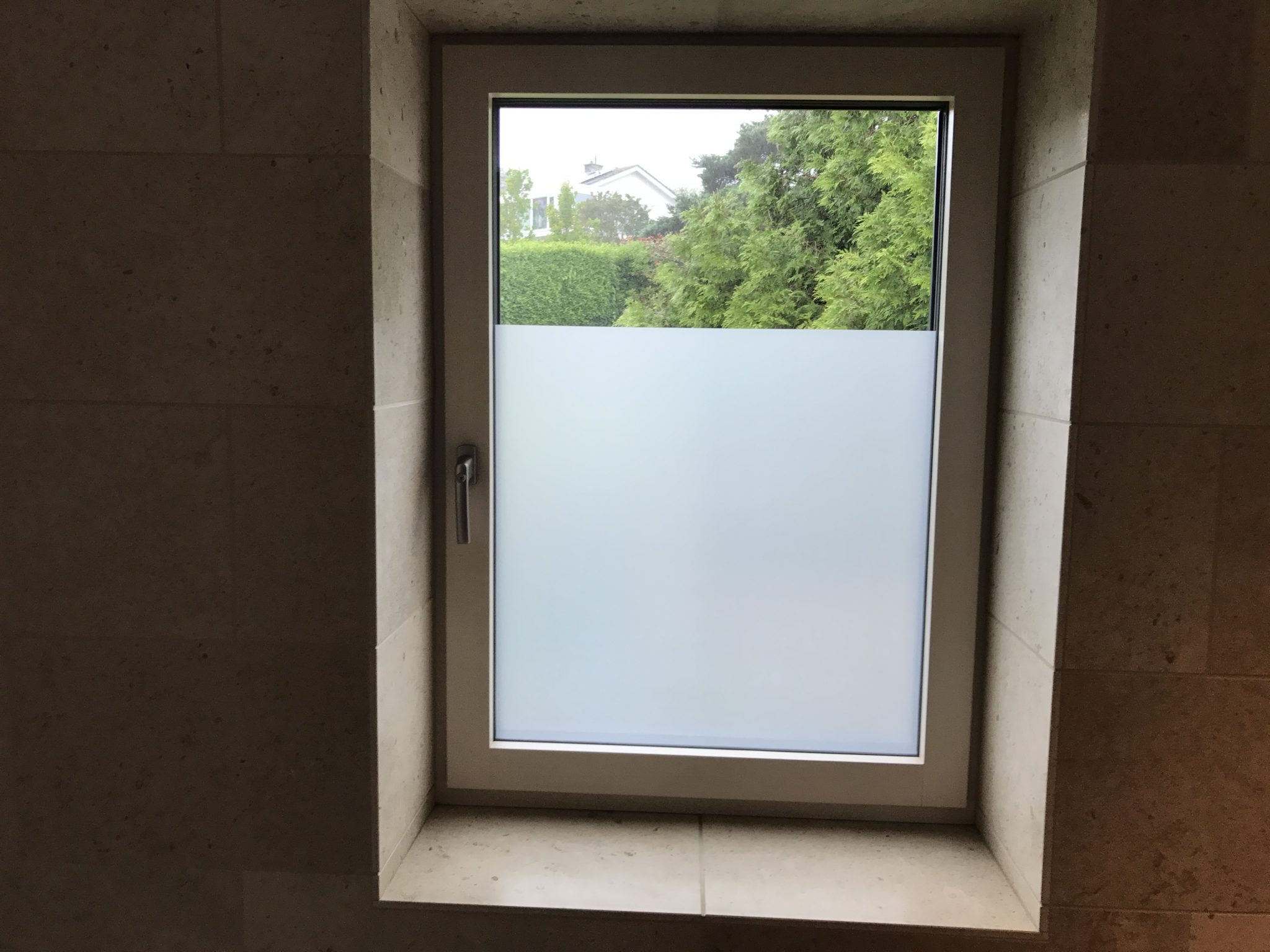 Bathroom privacy frosted film devon window tinting for Opaque glass for bathroom windows